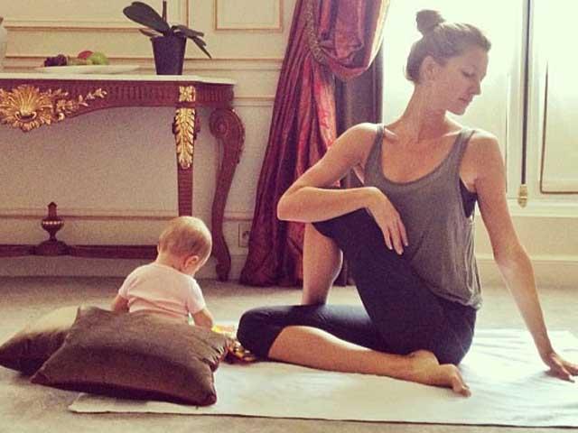 gisele-doing-yoga-with-baby-featured-image